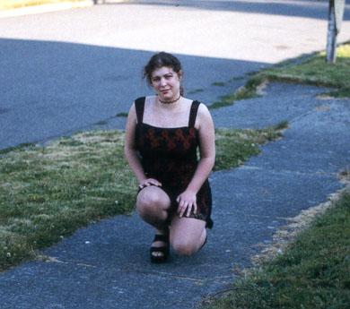 It's a red dress with black lace, and a sidewalk. (purpose of page is to display an image)