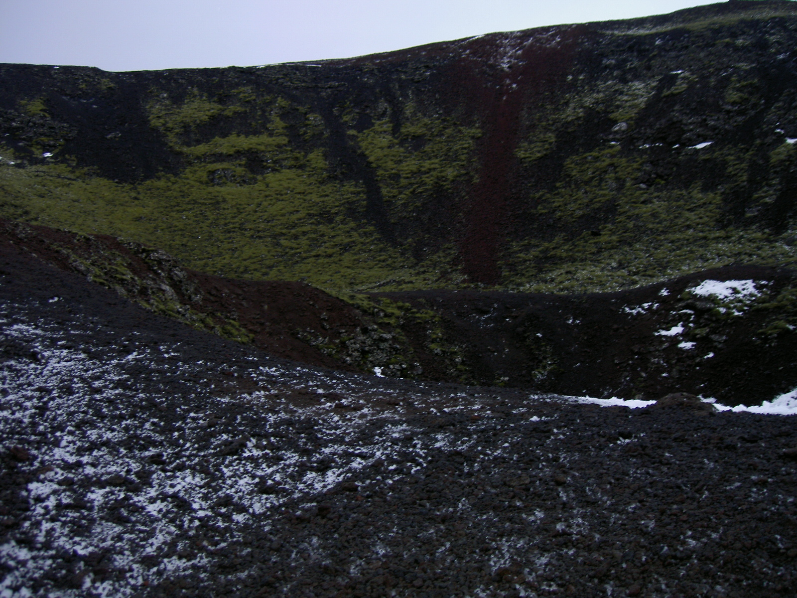 Looking down at the car while climbing toward Grabrok crater (purpose of page is to display an image)